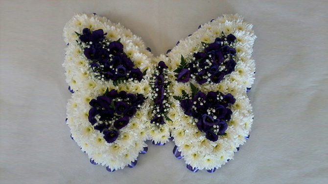 Butterfly shaped funeral flowers white and blue florist north Bristol FBF1