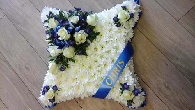 Cushion shaped funeral flowers white blue sash Bristol FCU1