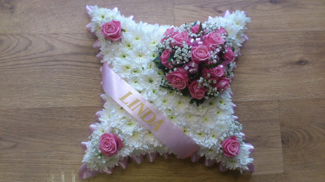 Cushion shaped funeral flowers white pink north Bristol FCU3