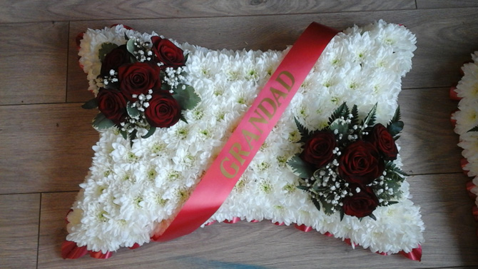 Pillow shaped funeral flowers grandad sash white red Bristol florist FPI2