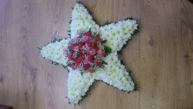 Star shaped funeral flowers white pink florist north Bristol FST2