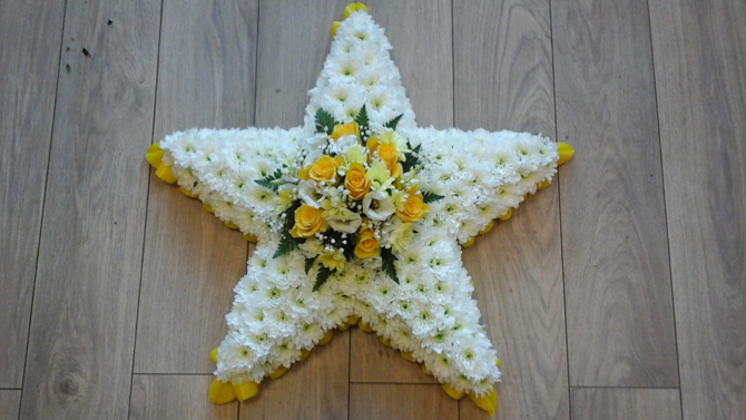 Star shaped funeral flowers white yellow florist north Bristol FST3
